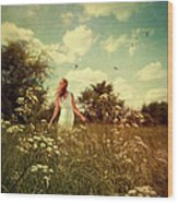 Young Girl Walking In Field Of Flowers Wood Print