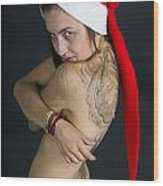 Young Woman Wearing Santa Hat Wood Print