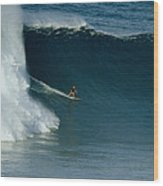 A Surfer Rides A Powerful Wave Wood Print