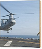 A Ch-46e Sea Knight Helicopter Prepares Wood Print