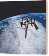 A Space Station In Orbit Above The Earth Wood Print by Stockbyte