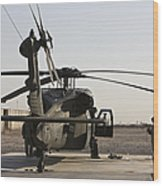 A Uh-60 Black Hawk Helicopter Parked Wood Print