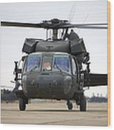 A Uh-60 Black Hawk Taxis Wood Print by Terry Moore