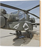 An Ah-64d Apache Helicopter At Cob Wood Print