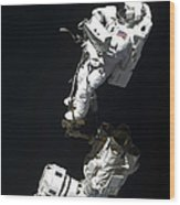 An Astronaut Anchored To A Mobile Foot Wood Print