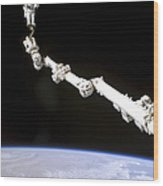 Astronaut Anchored To A Foot Restraint Wood Print