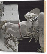 Astronaut Working On The International Wood Print