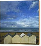 Beach Huts Under A Stormy Sky In Normandy Wood Print by Bernard Jaubert