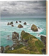 Cliffs Under Thunder Clouds And Turquoise Ocean Wood Print