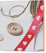 Close Up Of Ribbon, String And Buttons Wood Print