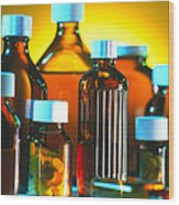 Collection Of Medicine Bottles With Safety Caps Wood Print by Tek Image