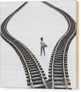 Figurine Between Two Tracks Leading Into Different Directions Symbolic Image For Making Decisions. Wood Print