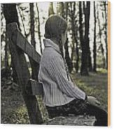 Girl Sitting On A Wooden Bench In The Forest Against The Light Wood Print