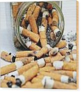 Jar Overflowing With Cigarette Butts Wood Print