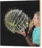 Man Over-inflating Balloon Wood Print
