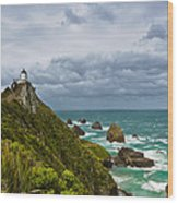 Nugget Point Light House And Dark Clouds In The Sky Wood Print