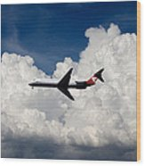 Passenger Jet And Clouds Wood Print