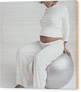 Pregnant Woman With Birthing Ball Wood Print