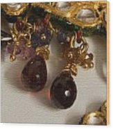 3 Hanging Semi-precious Stones Attached To A Green And Gold Necklace Wood Print