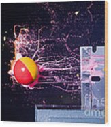 Paintball Shot At Razor Blade Wood Print