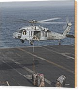 A Mh-60s Knighthawk Conducts A Vertical Wood Print