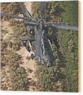 An Ah-64d Apache Helicopter In Flight Wood Print