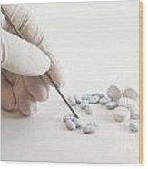 Gloved Hand And Medicinal Pills Wood Print