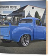 56 Studebaker At The Wigwam Motel Wood Print by Mike McGlothlen