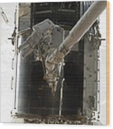 Astronauts Working On The Hubble Space Wood Print