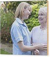 Nurse On A Home Visit Wood Print