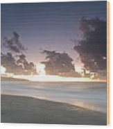 A Beach During Misty Sunset With Glowing Sky Wood Print