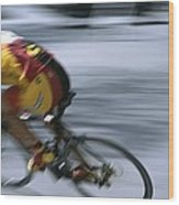 A Bicyclist Speeds Past In A Race Wood Print