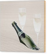 A Bottle Of Champagne With Two Glasses Wood Print