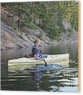 A Boy Kayaking Wood Print