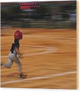 A Boy Runs During A Baseball Game Wood Print by Raul Touzon