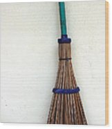 A Broom Stick On The Wall Wood Print