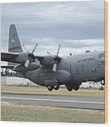 A C-130 Hercules Lands At Mcchord Air Wood Print