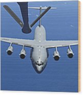 A C-17 Globemaster IIi Approaches Wood Print by Stocktrek Images