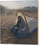 A Camper Reading In Her Tent Wood Print by Gordon Wiltsie