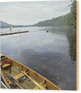 A Canoe Floats Next To A Dock Wood Print by Skip Brown