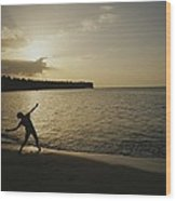 A Child, Silhouetted At Sunset, Throws Wood Print