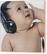 A Chubby Little Girl Listen To Music With Headphones Wood Print