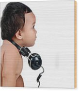 A Chubby Little Girl With Headphones Wood Print