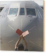 A Crew Chief Marshals In A C-141b Wood Print