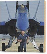 A Crew Chief Sprints Ahead Of A Blue Wood Print