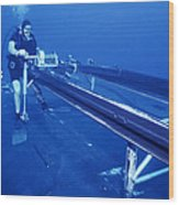 A Crewman Cranks Out The Dry Deck Wood Print by Michael Wood