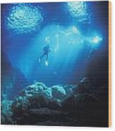 A Diver Hovers Inside The Archway As Wood Print