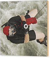 A Diver Is Hoisted Aboard An Sh-60f Wood Print