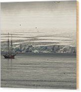 A Double-masted Sailboat Floats Near An Wood Print