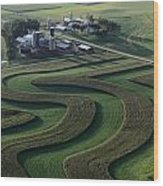 A Farm With Curved And Twisting Fields Wood Print